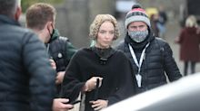 Jodie Comer and Adam Driver wear face coverings on set of The Last Duel