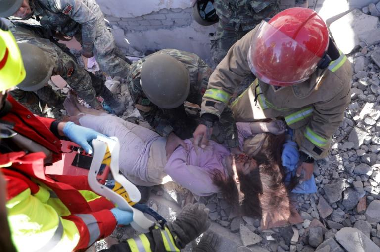 Rescuers were still recovering survivors a day after the earthquake hit (AFP Photo/STRINGER)