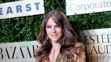 Elizabeth Hurley, 54, pairs fiery red top with a strawberry in latest Instagram post