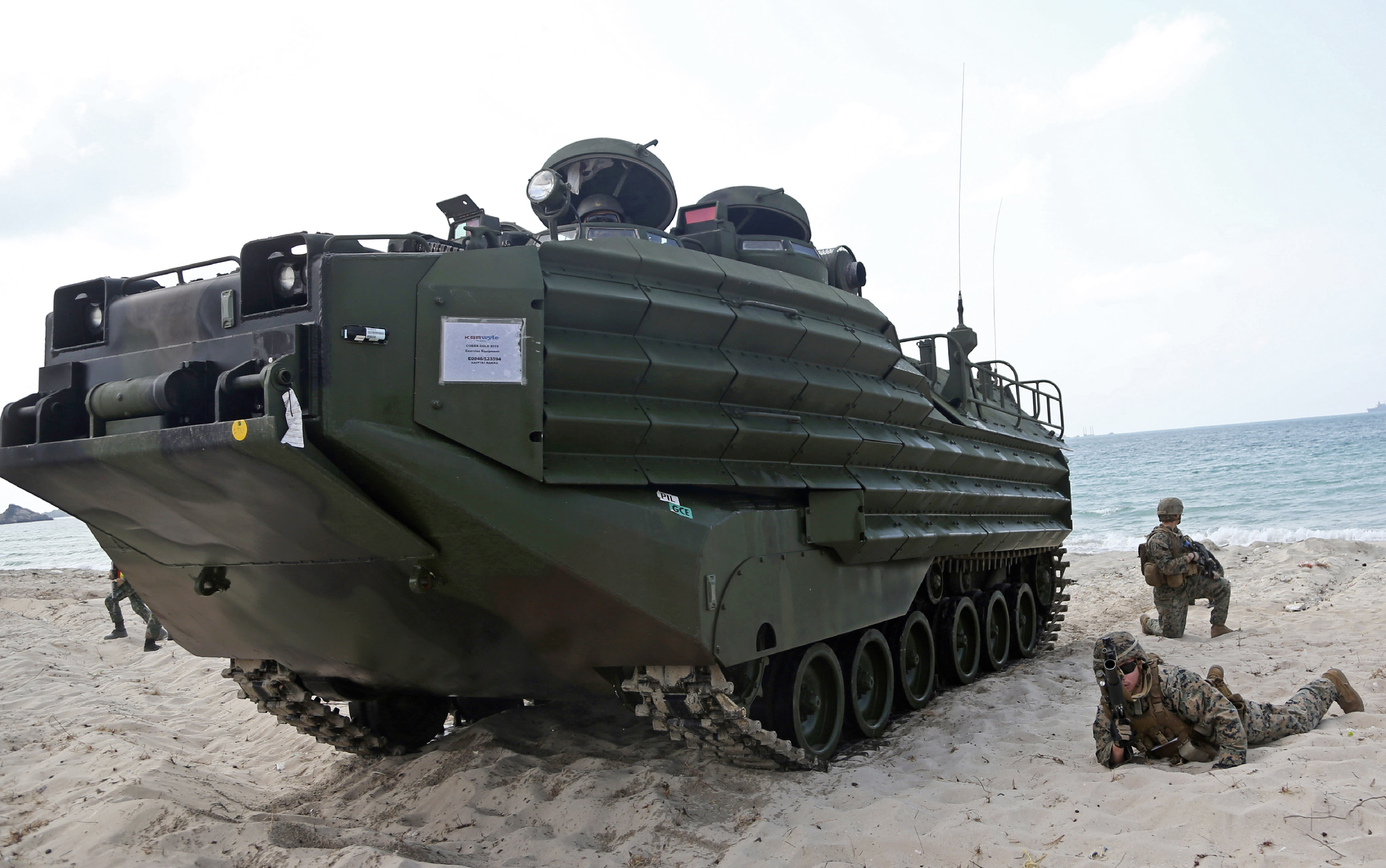 """FILE - U.S. soldiers land with an amphibious assault vehicle (AAV) during a U.S.-Thai joint military exercise titled """"Cobra Gold"""" on Hat Yao beach in Chonburi province, eastern Thailand, Saturday, Feb. 16, 2019. A training accident off the coast of Southern California in an AAV similar to this one has taken the life of one Marine, injured two others and left eight missing Thursday, July 30, 2020. In a Friday morning tweet, the Marines say the accident happened Thursday and search and rescue efforts are underway with support from the Navy and Coast Guard. (AP Photo/Sakchai Lalit)"""