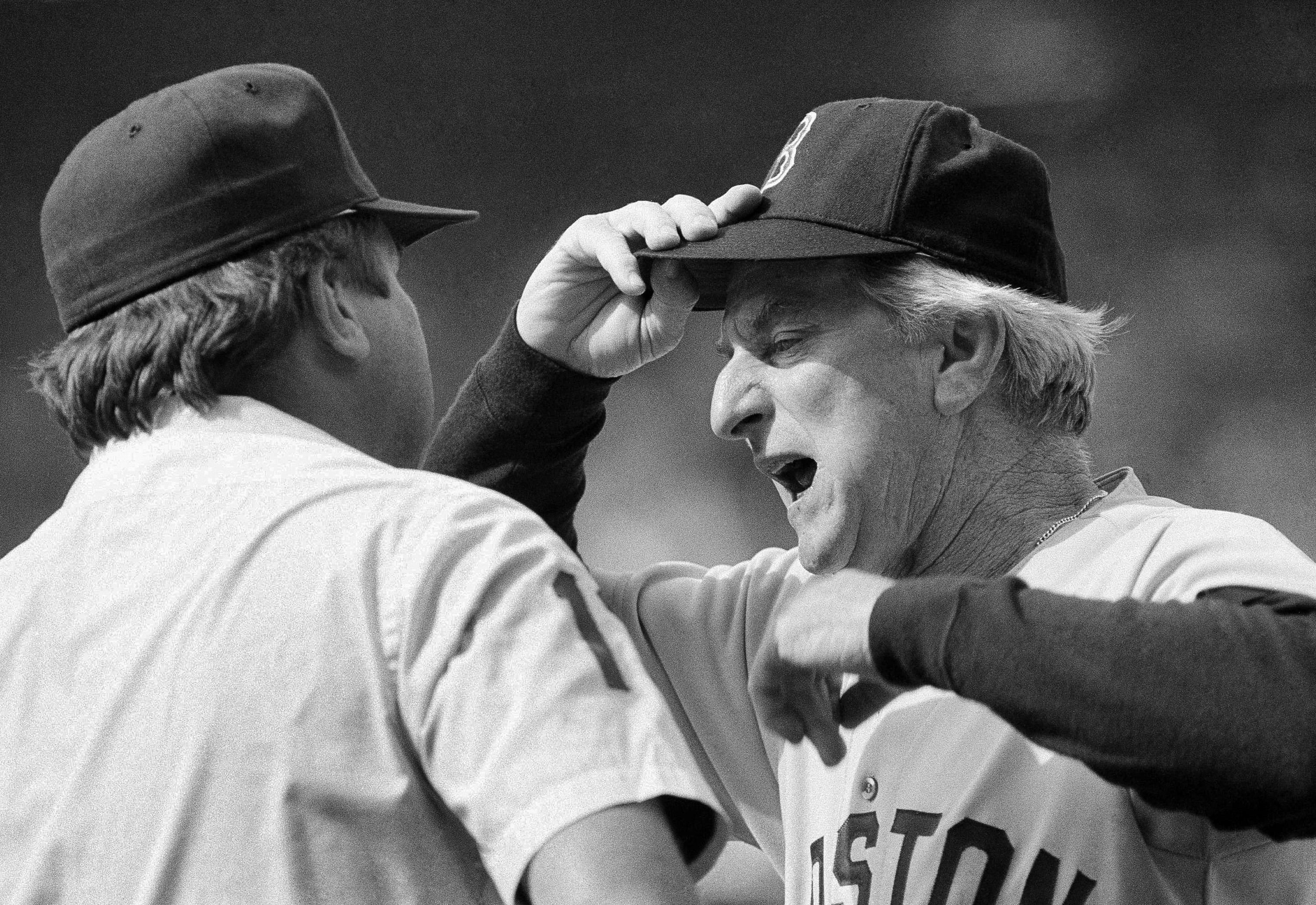 FILE - In this April 19, 1985, file photo, Boston Red Sox manager John McNamara, right, argues with first base umpire Derryl Cousins during a baseball game against the Chicago White Sox at Comiskey Park in Chicago. McNamara, who managed several Major League Baseball teams during his career, died Tuesday, July 28, 2020, in Tennessee. He was 88. (AP Photo/Fred Jewell, File)