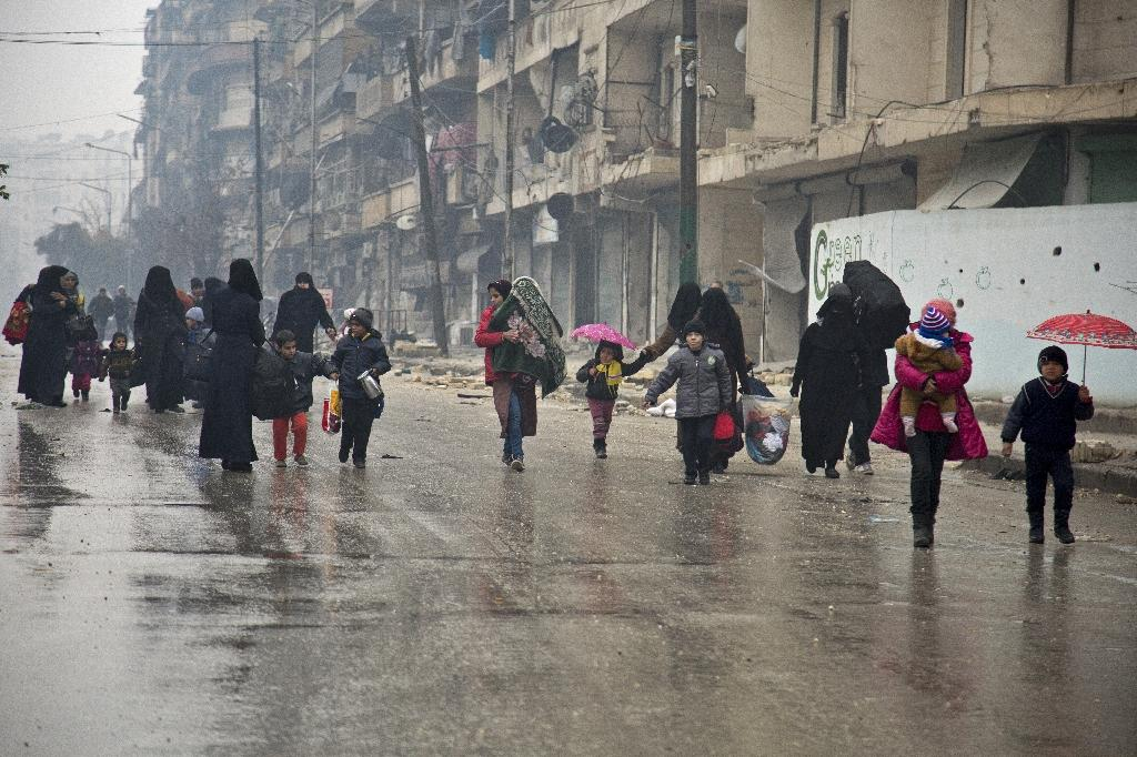 People leave a rebel-held area of Aleppo towards the government-held side on December 13, 2016 (AFP Photo/Karam al-Masri)