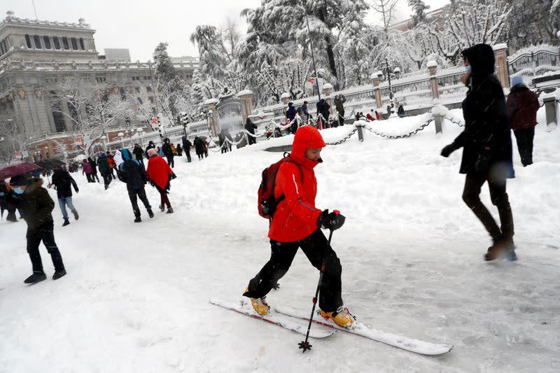 Spaniards ski through Madrid as snow storm kills four