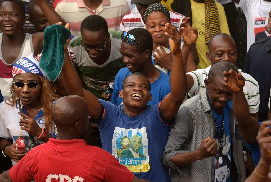 Supporters of George Weah celebrate after final results in Liberia's presidential election confirmed his as winner (AFP Photo/SEYLLOU)