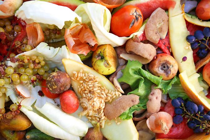 Different trash. Garbage sorting. Domestic waste for compost from fruits and vegetables.