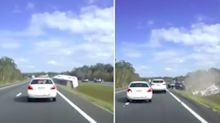 Terrifying footage shows caravan destroyed in highway rollover