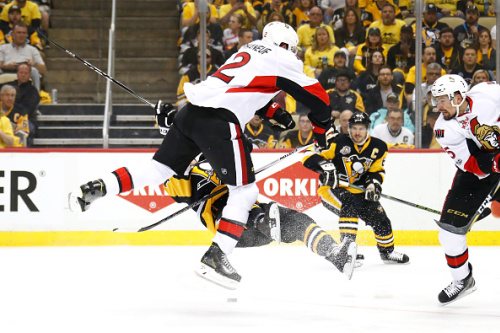 PITTSBURGH, PA - MAY 15: Dion Phaneuf #2 of the Ottawa Senators hits Bryan Rust #17 of the Pittsburgh Penguins during the first period in Game Two of the Eastern Conference Final during the 2017 NHL Stanley Cup Playoffs at PPG PAINTS Arena on May 15, 2017 in Pittsburgh, Pennsylvania. (Photo by Gregory Shamus/Getty Images)