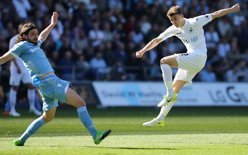 Tom Carroll scores Swansea's second - Rex Features