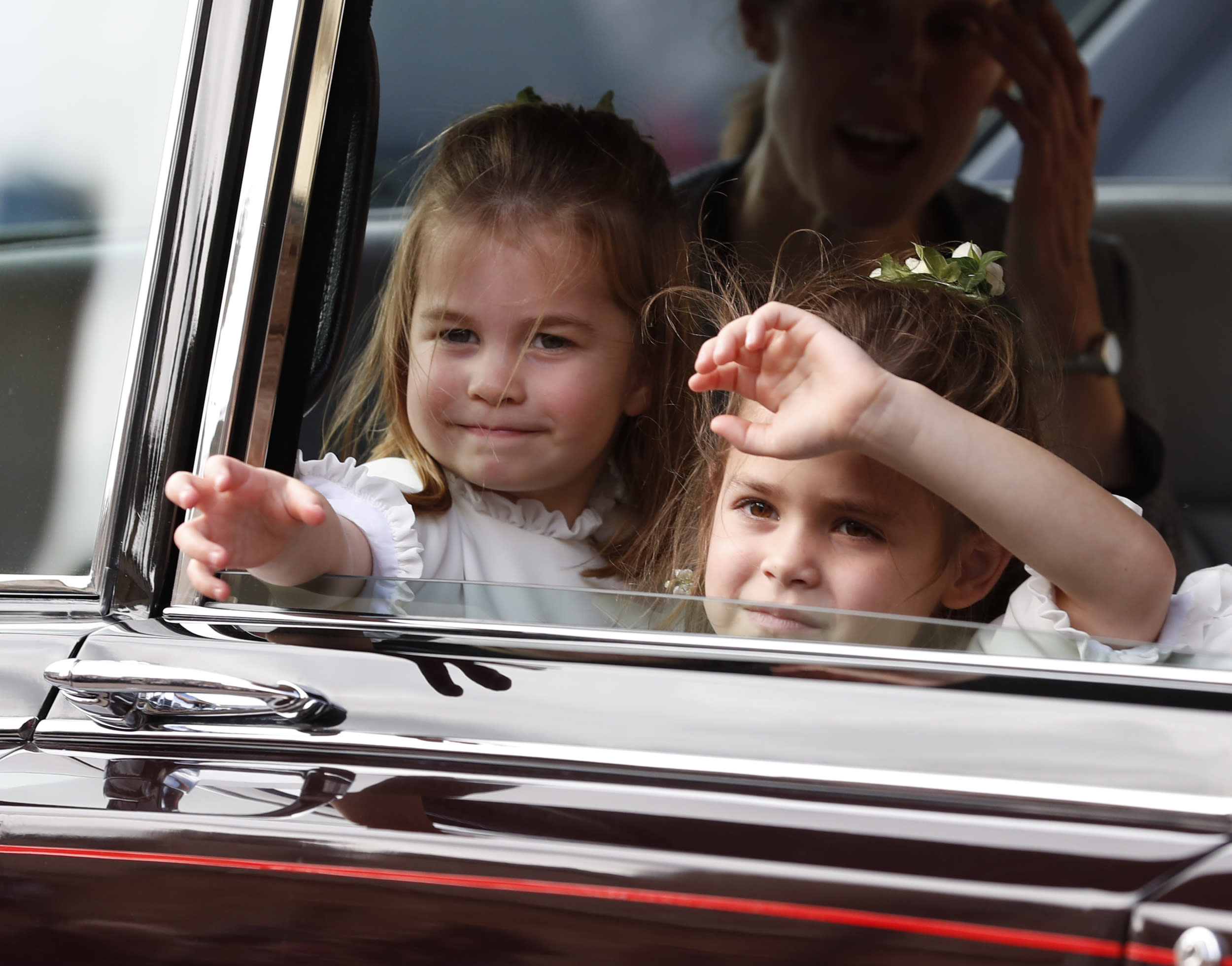 Flower Girls Princess Charlotte (left) and Theodora Williams wave to the crowds following the wedding of Princess Eugenie of York and Jack Brooksbank in St George's Chapel, Windsor Castle.