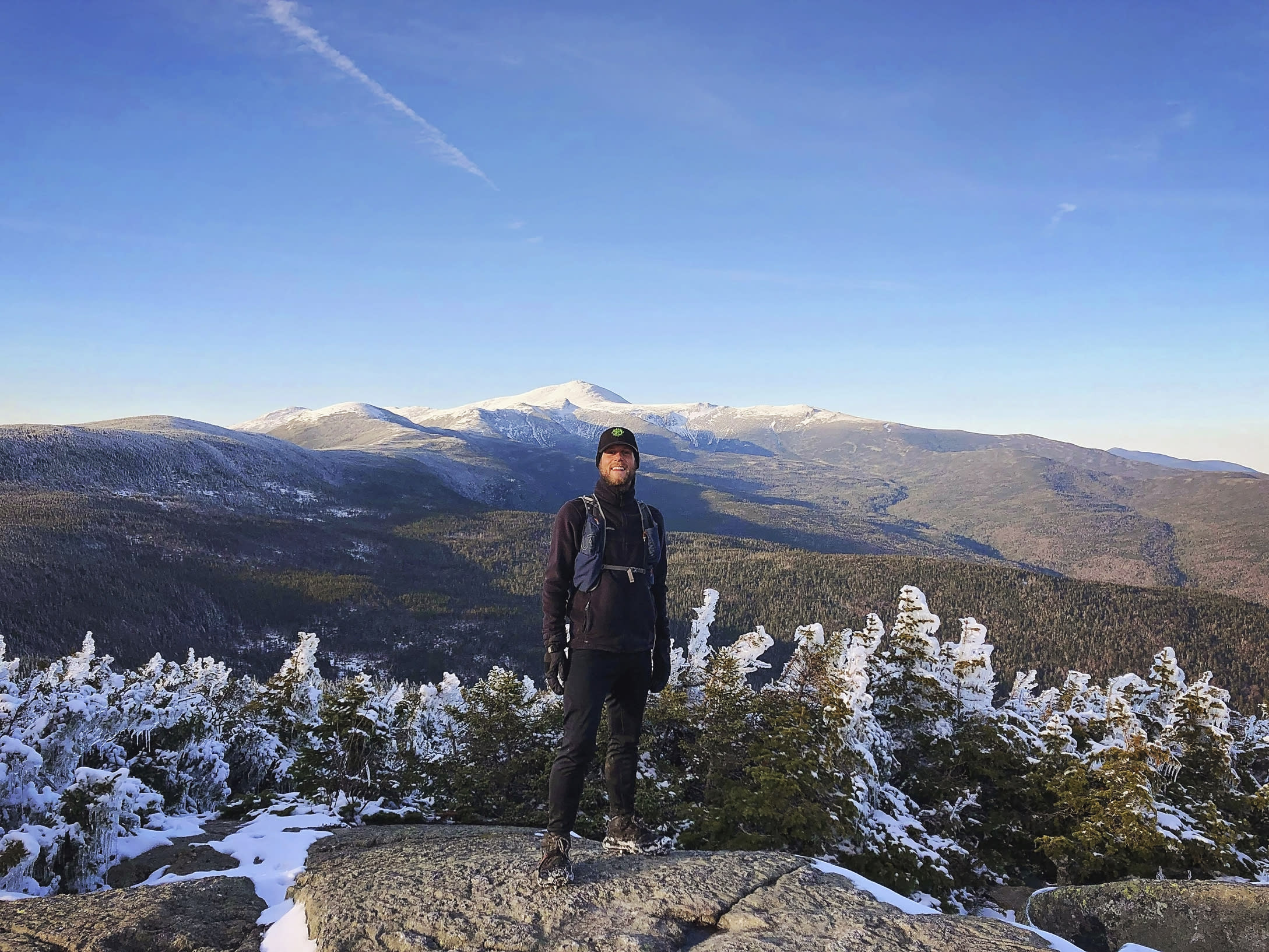 This photo taken by Philip Carcia on April 30, 2019, shows Carcia atop Mount Jackson as he completed his ninth consecutive month of hiking each of New Hampshire's mountains taller than 4,000 feet. On July 7, Carcia became only the second hiker to cram the grid into a single year, finishing in 319 days and beating the previous record by five weeks. He says he sees himself not as a conqueror but a pioneer, giving himself to the mountains he loves. (Philip Carcia via AP)