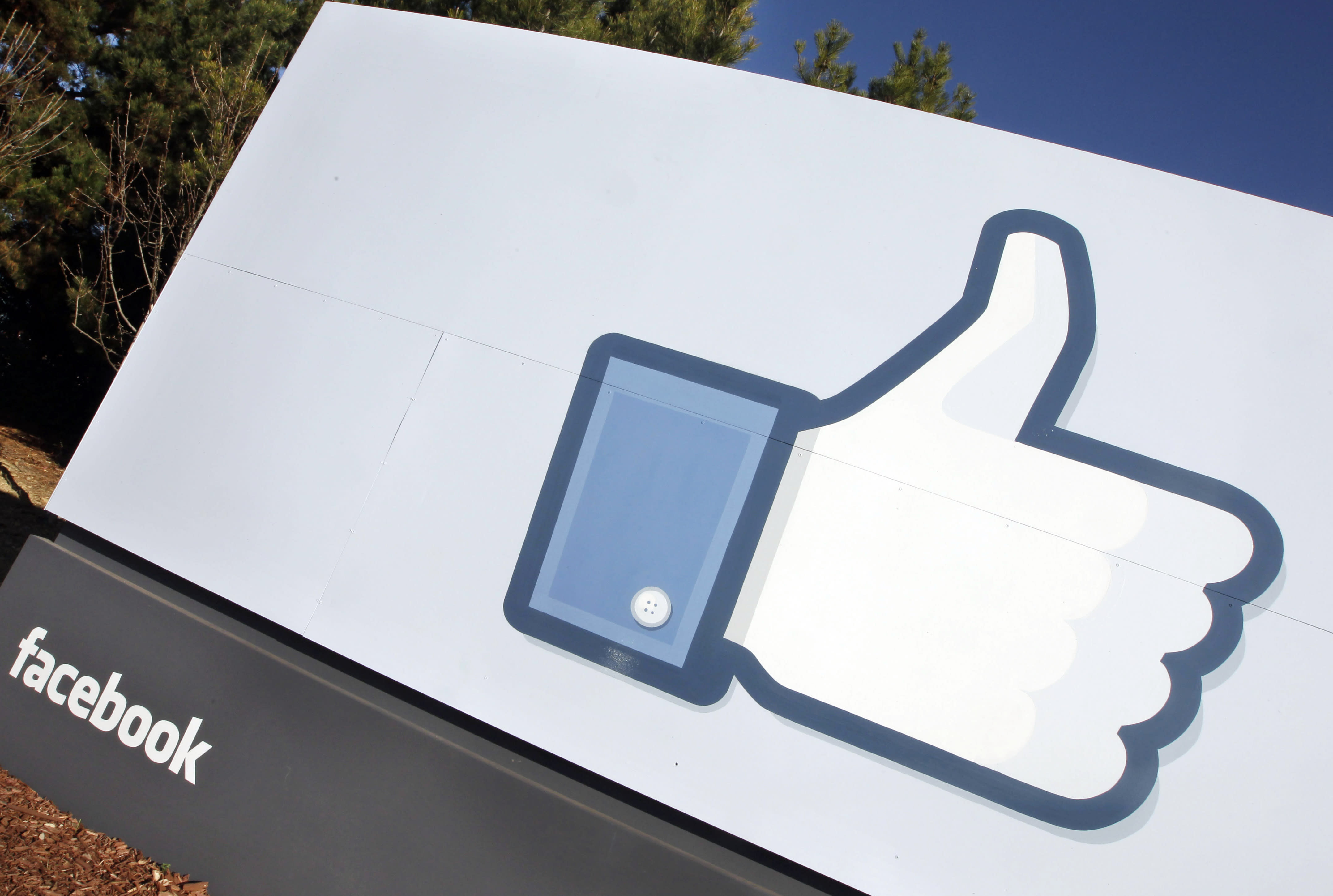 """FILE - A Jan. 12, 2012 file photo, shows the Facebook """"like"""" icon displayed outside of Facebook's headquarters in Menlo Park, Calif. The """"like"""" button on Facebook seems like a relatively clear way to express your support for something, but a federal judge says that doesn't mean clicking it is constitutionally protected speech. (AP Photo/Paul Sakuma)"""