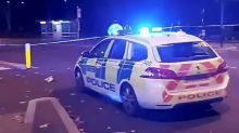 British police detain man after car crashed into police station