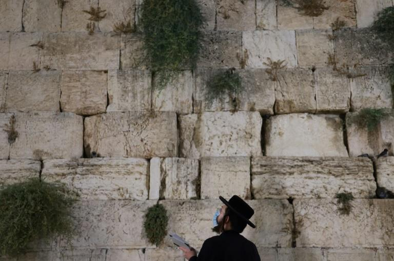 An ultra-Orthodox Jew prays at Jerusalem's Western Wall hours before a second coronavirus lockdown goes into force across Israel coinciding with the Jewish high holidays