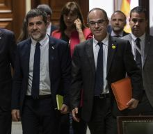 5 Catalan separatist leaders escorted to Spanish Parliament