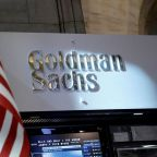 Goldman posts first quarterly loss in 6 years on tax hit; trading slumps