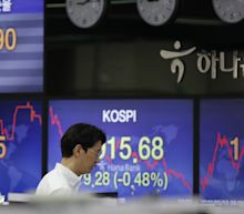 Asian markets inch higher as pandemic worries continue to weigh on investors