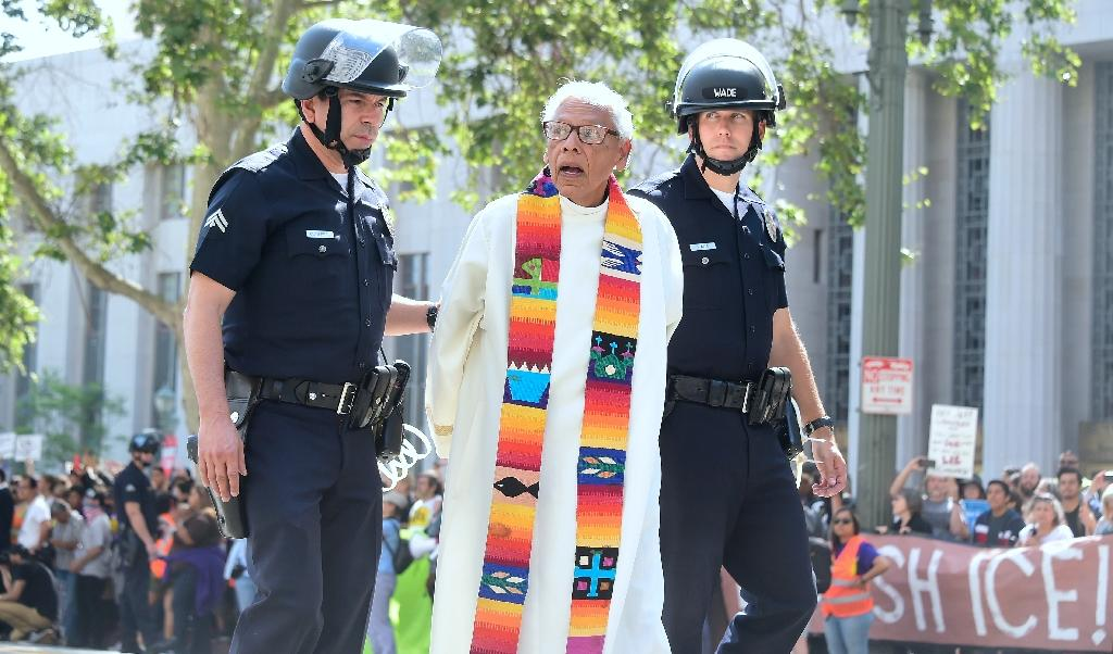 Faith leaders including Father Richard Estrada were arrested near the federal courthouse in Los Angeles, to protest a visit by US Attorney General Jeff Sessions, and the Trump administration's hard-line immigration policies (AFP Photo/Frederic J. BROWN)
