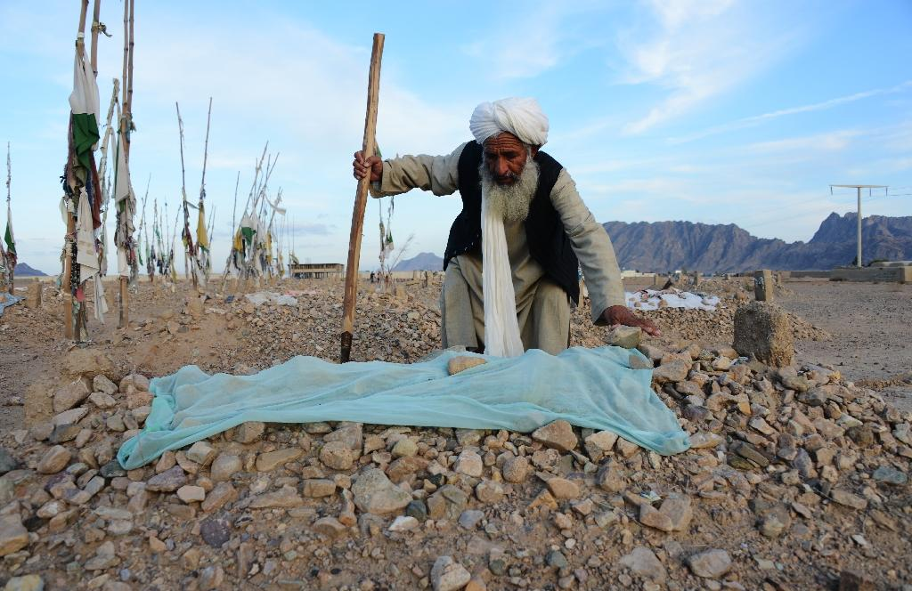 """Undertaker Malik Abdul Hakim works at the grave of a suicide attacker in a cemetery known as the """"Taliban graveyard"""" in the Zherai district of Kandahar (AFP Photo/Jawed Tanveer)"""
