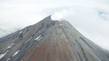 Alert level raised for Alaska volcano after explosion detected
