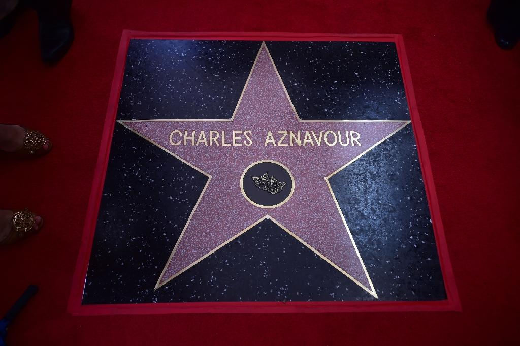 Singer Charles Aznavour was the recipient of the 2,618th star on Hollywood's Walk of Fame (AFP Photo/FREDERIC J. BROWN)