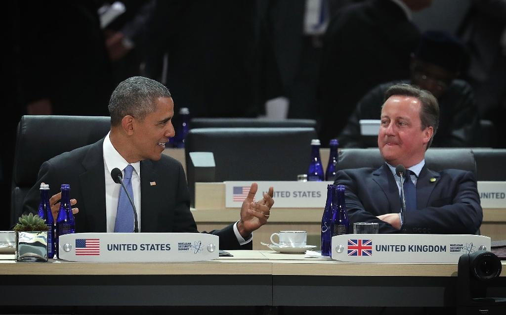 US President Barack Obama (L), seen here with British Prime Minister David Cameron at the Nuclear Security Summit in Washington earlier this month, is set to back Britain's continued EU membership on his visit to London (AFP Photo/Alex Wong)