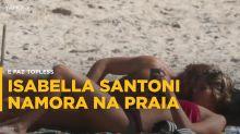 Isabella Santoni namora e faz topless em praia carioca