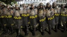 Protesters, police clash over Jokowi win