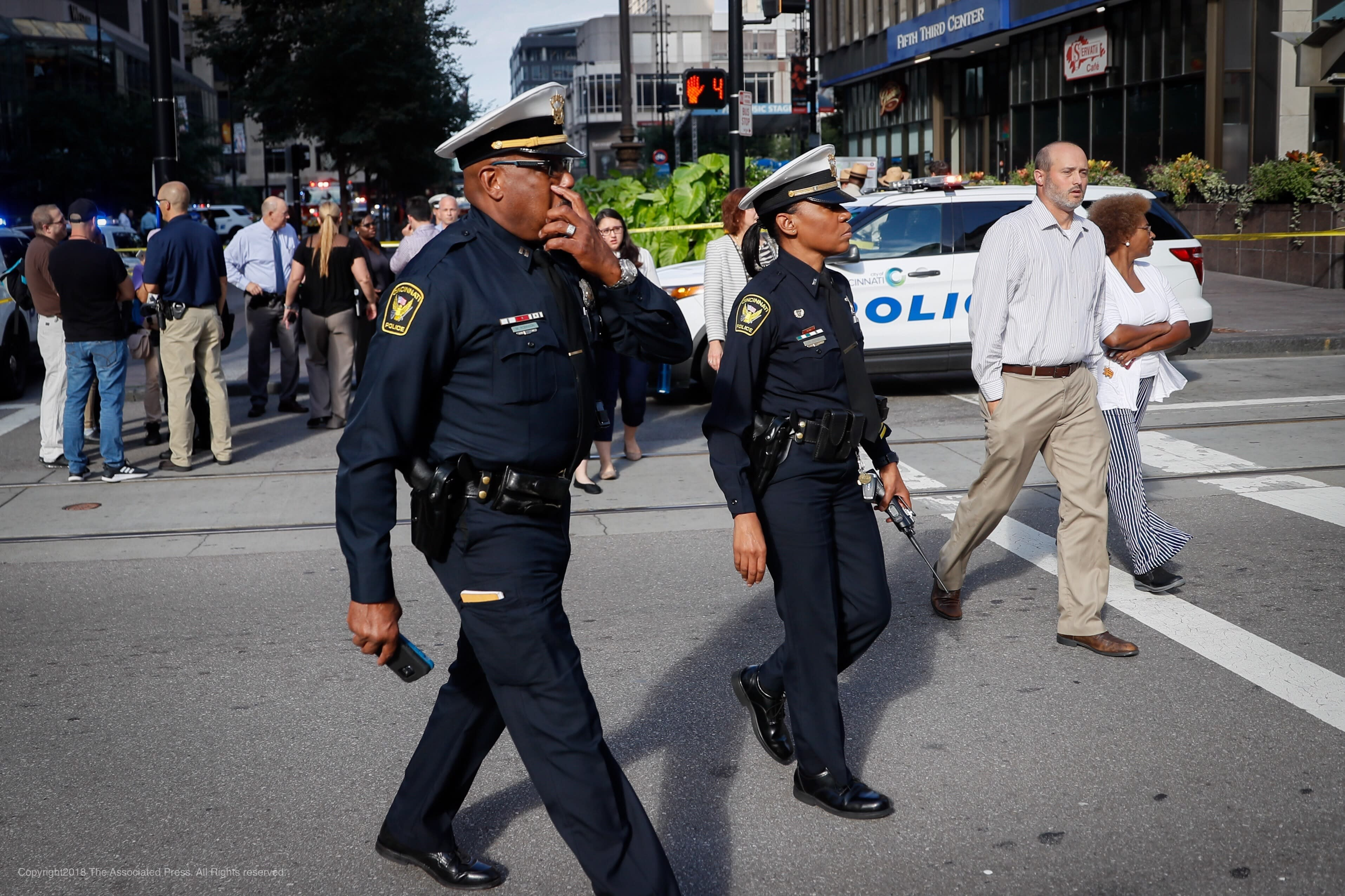 <p>Emergency personnel and police respond to a reported active shooter situation near Fountain Square, Thursday, Sept. 6, 2018, in downtown Cincinnati. (Photo: John Minchillo/AP) </p>