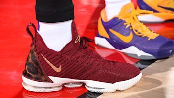 Why did LeBron wear Cavs-colored shoes?