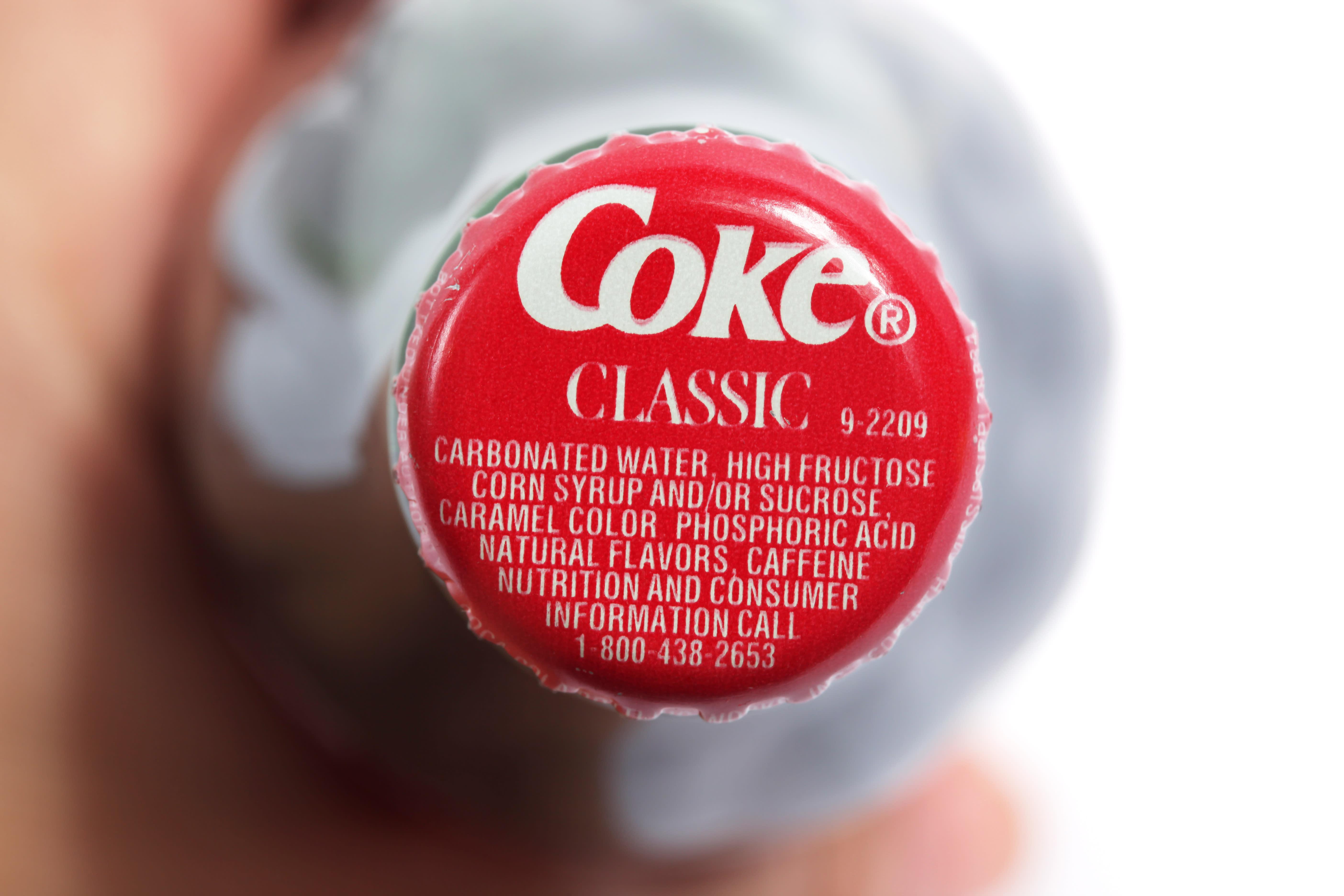 Coke beating earnings raises revenue forecast for the beverage company