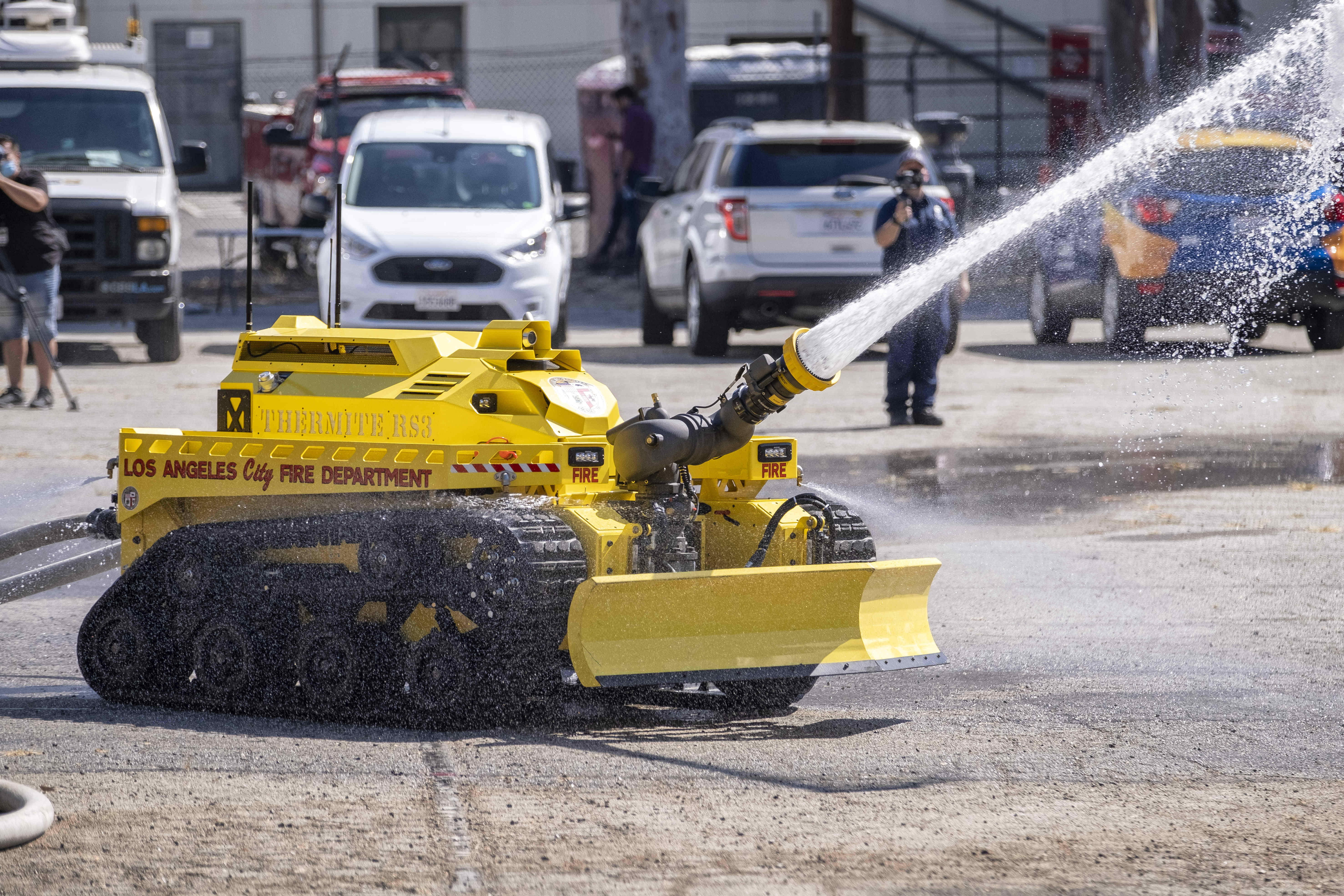 The Los Angeles City Fire Department demonstrates their new Thermite RS3 robotic vehicle in a parking lot adjacent to the Frank Hotchkin Memorial Training Center in Los Angeles, Tuesday, Oct. 13, 2020. (Hans Gutknecht/The Orange County Register via AP)