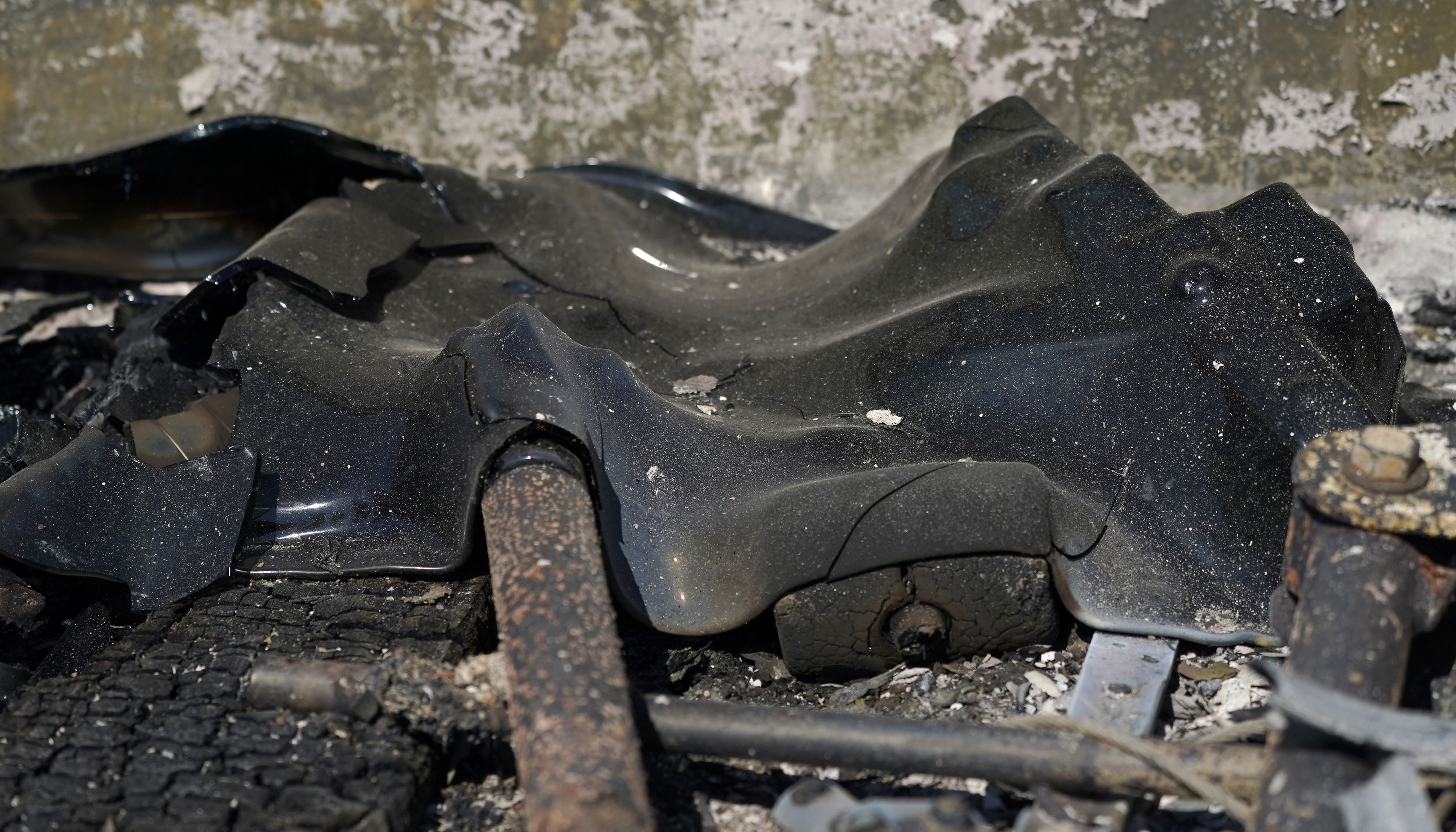 Melted glass from the back window of a truck is shown, Tuesday, Sept. 8, 2020, after a wildfire destroyed homes and outbuildings in Graham, Wash., overnight south of Seattle. (AP Photo/Ted S. Warren)