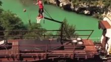 Acrobatic basketball team shows off crazy stunts on top of moving train
