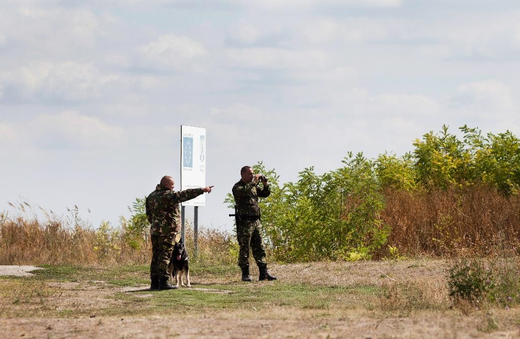 Policemen patrol the border area at Triplex Confinium, western Romania, where the borders of Romania, Hungary and Serbia meet (AFP Photo/Cornel Putan)