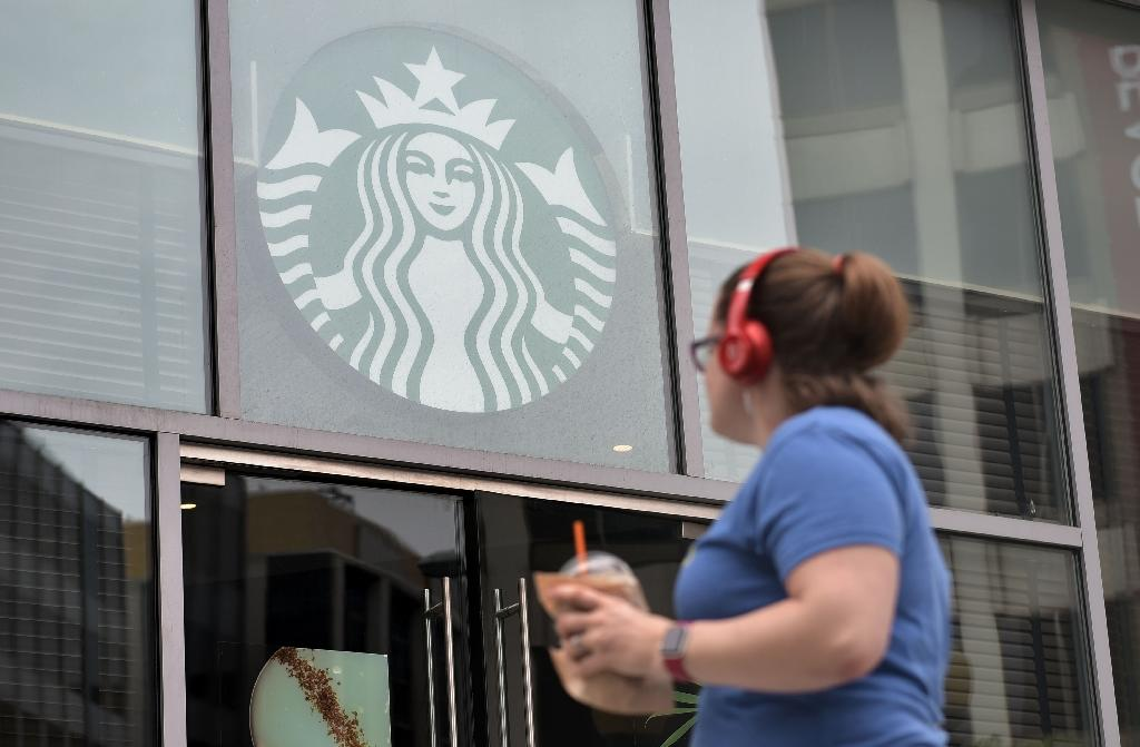 Starbucks decided to sacrifice millions in lost sales to close for an afternoon of nationwide racial-bias training, after two black men were arrested in a Philadelphia store in April (AFP Photo/Mandel Ngan)