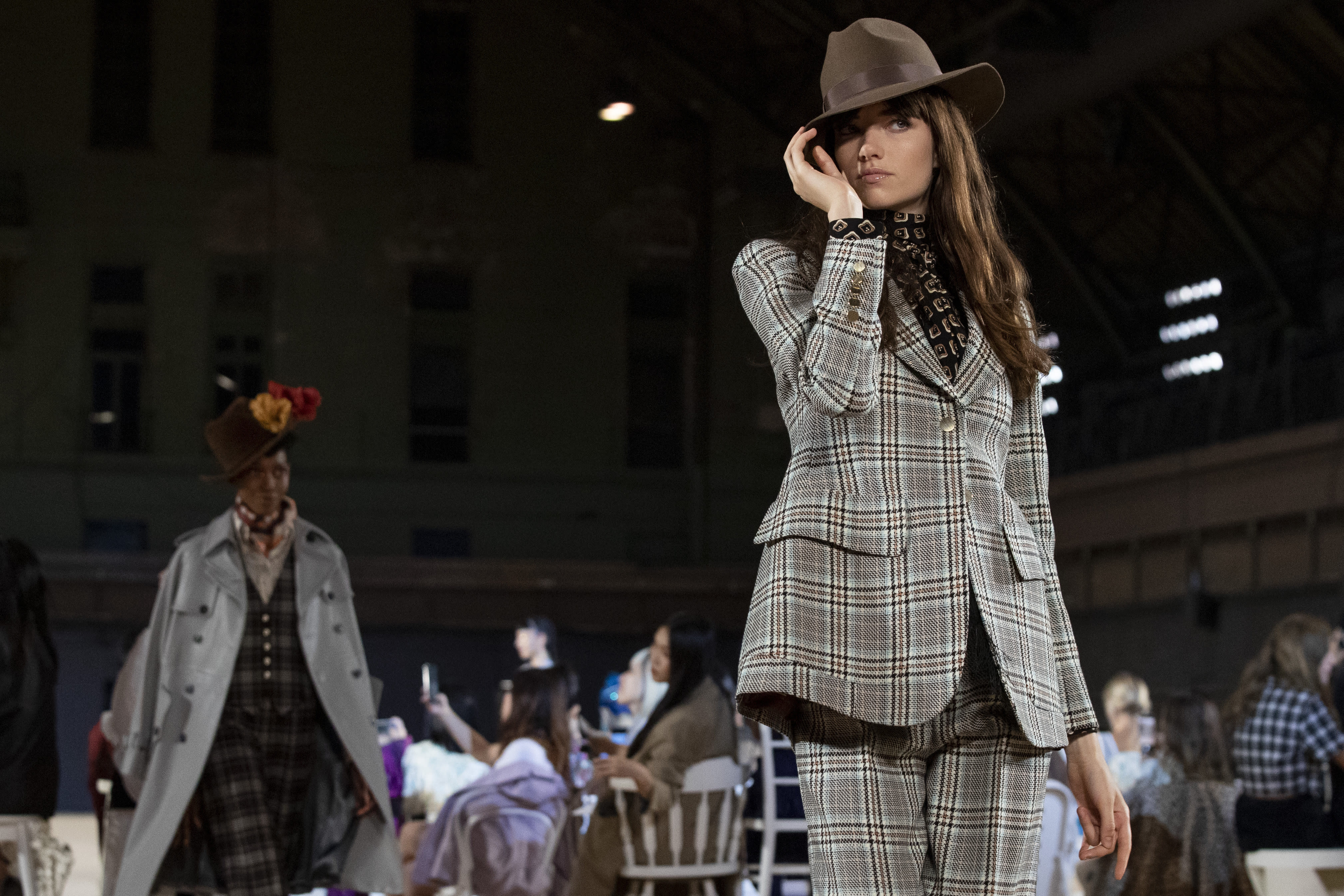 FILE - The Marc Jacobs collection is modeled during Fashion Week in New York on Sept. 11, 2019. With no celebs in the front row, no paparazzi chasing models down the streets, no stiletto-heeled crowds and no live shows at all, is there even a point to doing Fashion Week in 2020? Well, yes, say organizers: It's about business. And jobs. And survival. (AP Photo/Mary Altaffer, File)