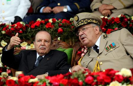 FILE PHOTO: Algeria's President Abdelaziz Bouteflika gestures while talking with Army Chief of Staff General Ahmed Gaed Salah during a graduation ceremony of the 40th class of the trainee army officers at a Military Academy in Cherchell 90 km west of Algiers, Algeria June 27, 2012. REUTERS/Ramzi Boudina/File Photo
