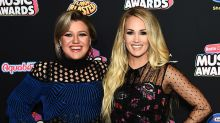Kelly Clarkson Goes Edgy & Carrie Underwood Goes Whimsical on the Radio Disney Music Awards Red Carpet