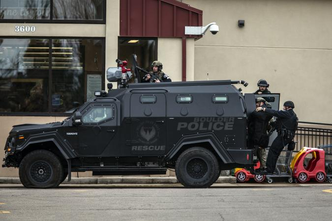 BOULDER, CO - MARCH 22: SWAT teams advance through a parking lot as a gunman opened fire at a King Sooper's grocery store on March 22, 2021 in Boulder, Colorado. Ten people, including a police officer, were killed in the attack.   (Photo by Chet Strange/Getty Images)