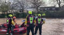 Rescuers Shake Their Heads as Pickup Drives into Floodwater in England