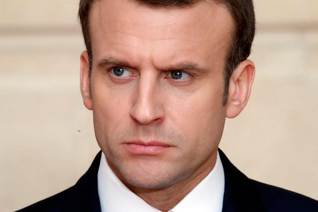 British Prime Minister Theresa May and French President Emmanuel Macron are facing anger from lawmakers for conducting air strikes with the United States in Syria in their first major military action since coming to power (AFP Photo/CHARLES PLATIAU)