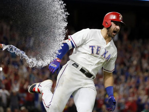 Joey Gallo celebrates after hitting a three-run walk-off homer for the Rangers. (AP)