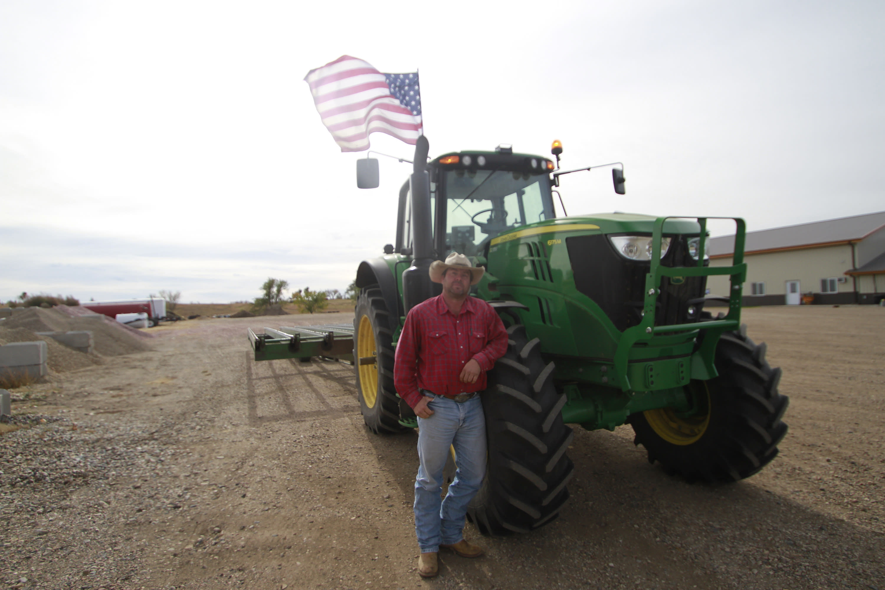 Cody Tobin poses for a photo on Friday, Oct. 16, 2020, in Wessington Springs, S.D. Tobin operates a ranch in Jerauld County, which has seen one of the nation's highest rates of coronavirus cases per person, but said he is not afraid of the virus. (AP Photo/Stephen Groves)
