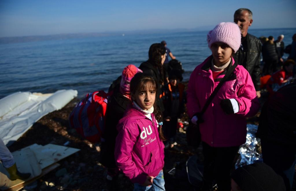 Migrants and refugees arrive on the Greek island of Lesbos after crossing the Aegean Sea from Turkey on November 18, 2015; the Aegean islands are at the forefront of the greatest migration challenge facing the European Union since World War II (AFP Photo/Bulent Kilic)