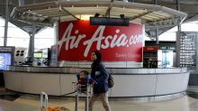 Malaysia's AirAsia swings to net loss as FX fluctuations bite