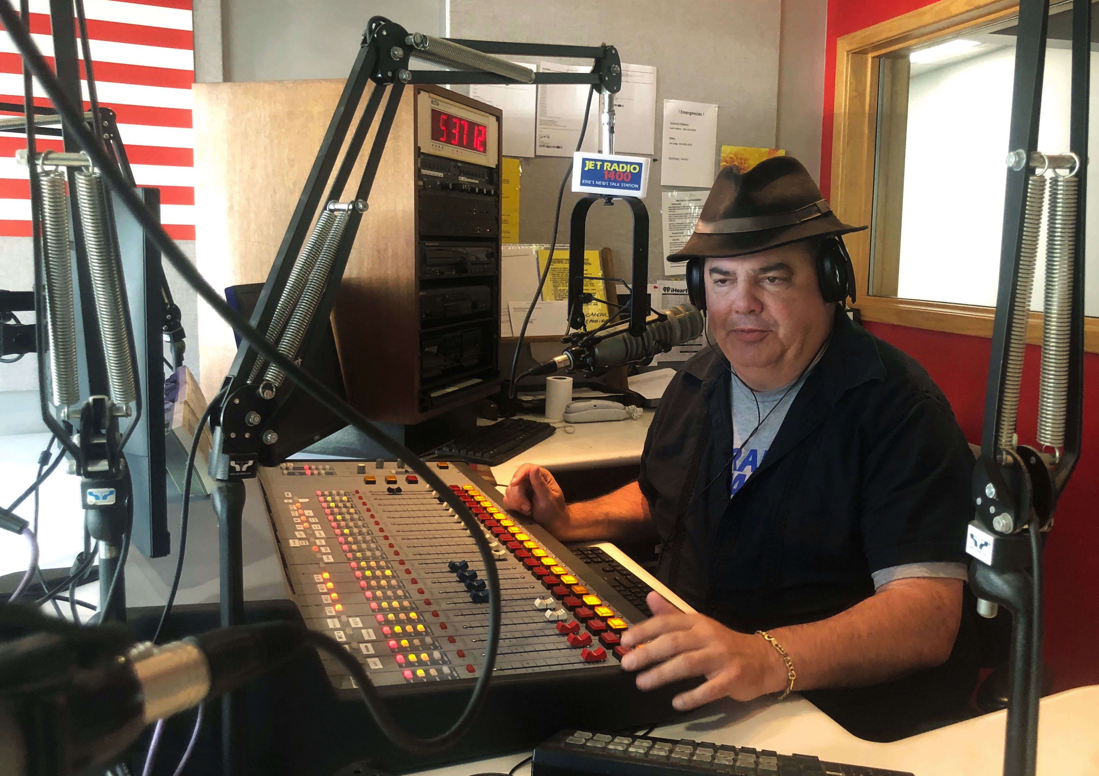 In this Friday, Aug. 2, 2019, photo, Scott Bremner, talk radio host, works in Erie, Pa. Months ago, Bremner had tried to establish if his listeners could agree on a fundamental question: what is racism? The answer, he realized, is no, we don't even agree on that. (AP Photo/Claire Galofaro)