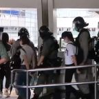 Handcuffed Protesters Led Away by Hong Kong Police