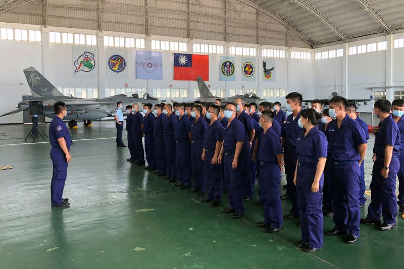 Soldiers gather in front of Indigenous Defense Fighter (IDF) fighter jets at Makung Air Force Base in Taiwan's offshore island of Penghu
