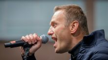 Mass raids target Russian opposition chief