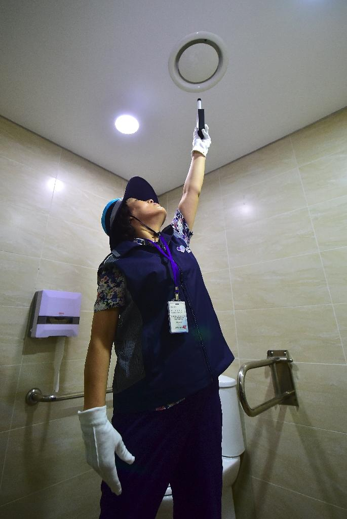 Many of South Korea's tech-savvy peeping Toms use spy cameras to gather footage from changing rooms and toilet stalls (AFP Photo/Jung Yeon-Je)